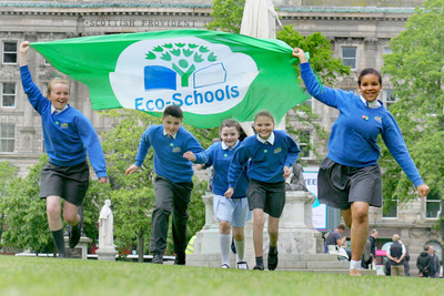 Children with Eco-Schools flag